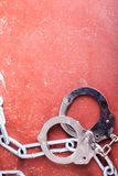 Handcuffs and chains Stock Photos