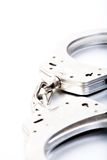 Handcuffs close-up hoog sleutel Stock Afbeelding