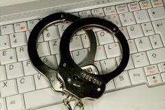 Handcuffs and Computer Royalty Free Stock Images