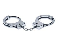 Handcuffs die op wit wordt geïsoleerde stock afbeeldingen