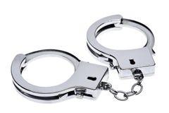 Handcuffs die op wit wordt geïsoleerdk Royalty-vrije Stock Afbeelding