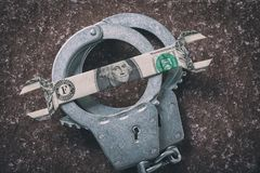 Handcuffs and dollar. Concept on the subject of fraud in the foreign exchange market. Top view stock photo