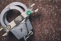 Handcuffs and dollar with copy space. Concept on the subject of fraud in the foreign exchange market. Top view stock photography