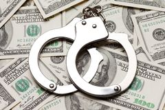Handcuffs on dollar currency Stock Photos