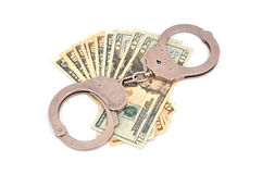 Handcuffs and dollars Stock Images