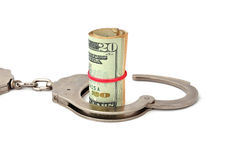 Handcuffs and dollars Royalty Free Stock Photos