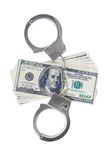 Handcuffs and dollars isolated Stock Photo
