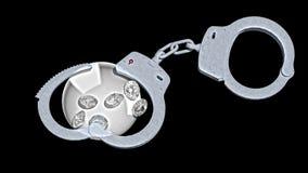 Handcuffs en diamanten die ondeugd in liefdesavonturen symboliseren Royalty-vrije Stock Foto