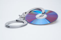 Handcuffs en DVD Royalty-vrije Stock Afbeeldingen