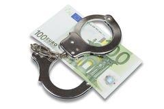 Handcuffs en Euro geld Stock Fotografie