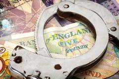 Handcuffs en geld Stock Foto's