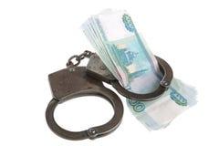 Handcuffs en geld op witte achtergrond Stock Foto
