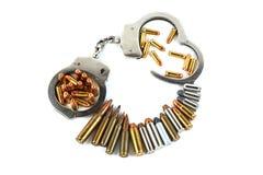 Handcuffs en kogels Royalty-vrije Stock Afbeeldingen