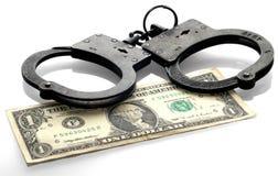 Handcuffs en muntstukken Royalty-vrije Stock Afbeelding