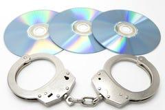 Handcuffs en optische schijven Stock Afbeelding