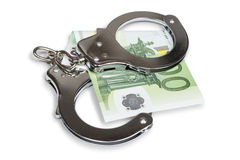 Handcuffs and Euro money Stock Image