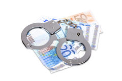 Handcuffs and Euro money Royalty Free Stock Image