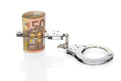Handcuffs with euro notes Stock Photo