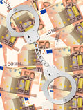 Handcuffs on fifty euro background vertical. Handcuffs on fifty euros background Stock Photography