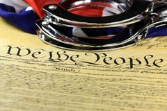 Handcuffs and flag on US Constitution - Fourth Amendment Stock Images