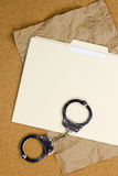 Handcuffs and Folder Royalty Free Stock Photos