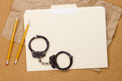 Handcuffs and Folder Royalty Free Stock Photo