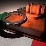 Handcuffs, gavel and book over Italy flag Royalty Free Stock Images