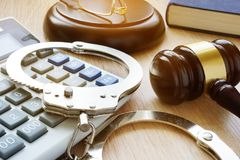 Handcuffs, gavel and calculator. Financial fraud. Handcuffs, gavel and calculator. The Financial fraud stock image