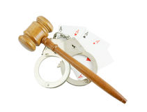 Handcuffs, gavel and cards isolated Stock Images