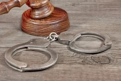 Handcuffs and Gavel in Courtroom Stock Photos