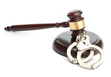 Handcuffs and gavel Stock Images