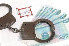 Handcuffs, geld en technisch paspoort met het plan Stock Fotografie