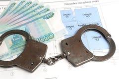 Handcuffs, geld met het plan van het huis  Royalty-vrije Stock Afbeelding