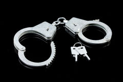 Handcuffs On A Glass Royalty Free Stock Image