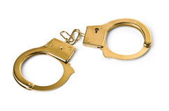 Handcuffs golden Stock Photos