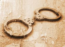 Handcuffs on grunge Stock Image