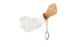Handcuffs, hand. Stock Foto's