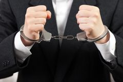 Handcuffs on hands Royalty Free Stock Photos