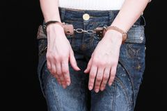 Handcuffs on hands Royalty Free Stock Image