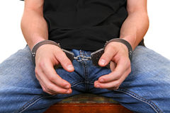 Handcuffs on Hands closeup Royalty Free Stock Photos