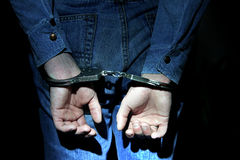 Handcuffs on Hands closeup Royalty Free Stock Image
