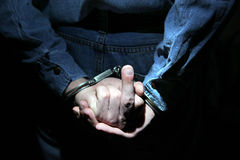Handcuffs on Hands closeup Stock Photography