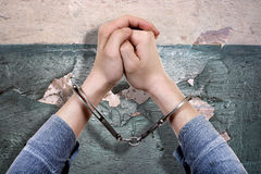 Handcuffs on the Hands closeup Stock Photos