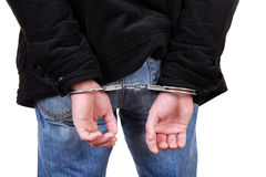 Handcuffs on Hands closeup Stock Image