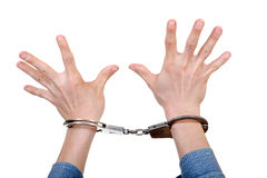 Handcuffs on Hands closeup Royalty Free Stock Photo