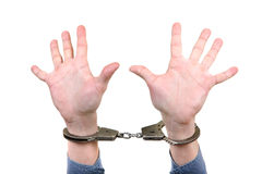Handcuffs on Hands closeup Stock Images