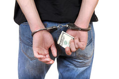 Handcuffs in Hands with Money Stock Photo
