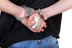 Handcuffs in Hands with Money Stock Photos
