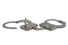 Handcuffs in hartvorm en sleutel binnen geïsoleerd Royalty-vrije Stock Afbeelding