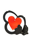 Handcuffs and heart Stock Image